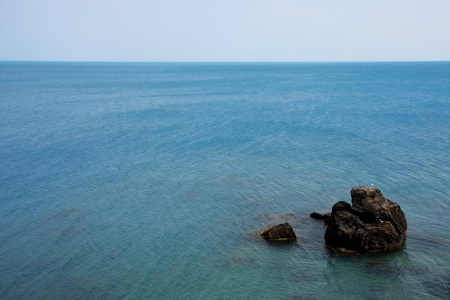 A lonely expanse of rock in the water