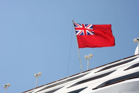 English flag at the stern of a large merchant ships Stock Photo
