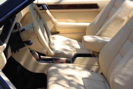 Vehicle interior trimmed in leather and wood