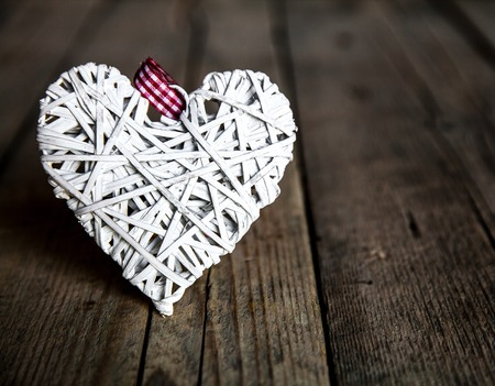 White heart on a wooden background. Red, Valentines Day, Day of the enamored photo