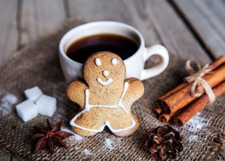 Christmas food. Gingerbread man cookies in Christmas setting. Xmas dessert photo