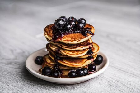 Pancakes with jam and currants photo