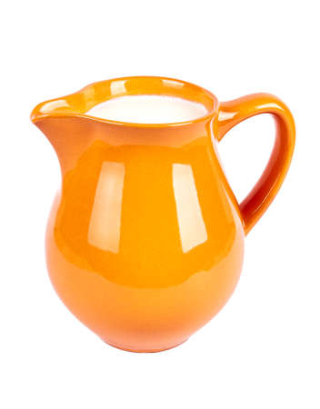 earthenware: crock orange and milk Stock Photo
