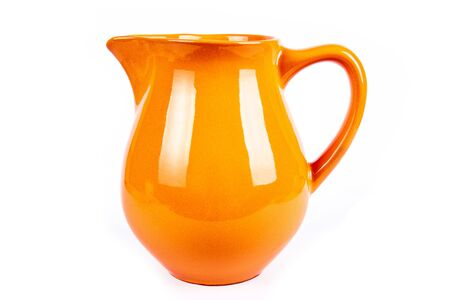 crock: crock orange and milk Stock Photo