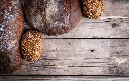 food. composition of bread with blank place for text on wooden background photo