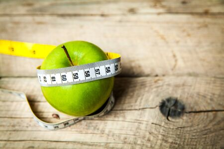 centimeter: Apple and centimeter. Healthy eating Stock Photo