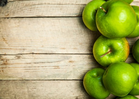 green apples: green apples on wooden background
