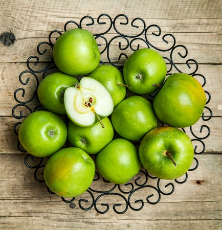 apples in a bowl on wooden background photo