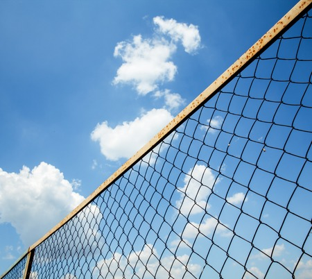 Wire mesh fence against blue sky photo