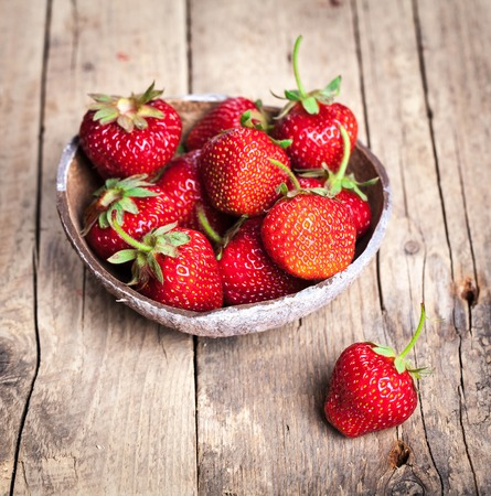 fruit. Fresh strawberries on old wooden background