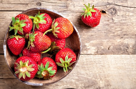 strawberry baskets: fruit. Fresh strawberries on old wooden background
