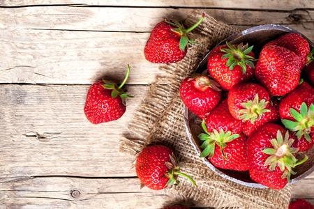 fresh strawberries: fruit. Fresh strawberries on old wooden background