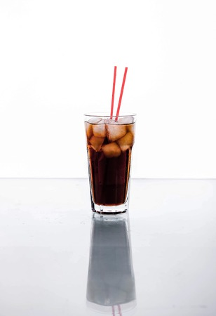 red tube: Cola in a glass with ice with red tube. soft drinks