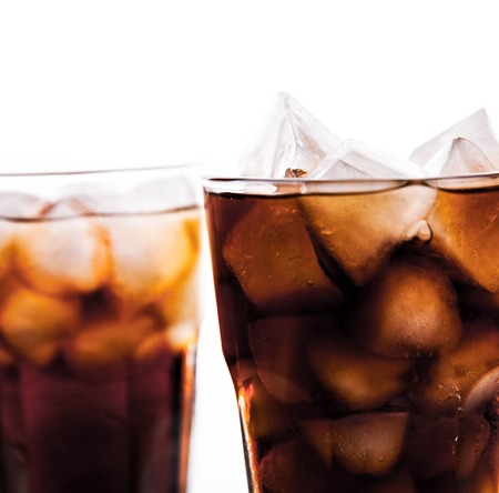 liquid reflect: two glasses of cola on white background.