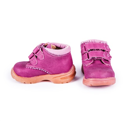 mud and snow: pink child boots white isolated