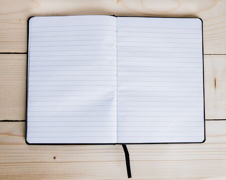 panelling: Blank notepad on a wooden surface. Stock Photo