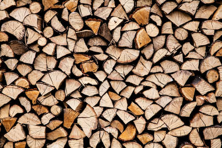 dry chopped firewood logs ready for winter photo