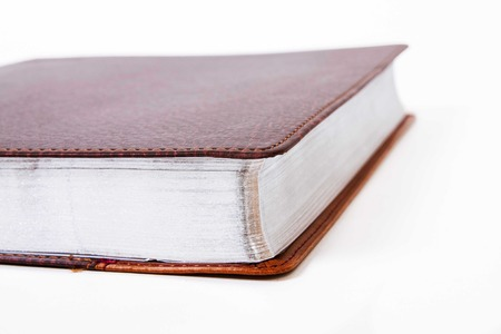 cognition: closed book pages with silver on a white background Stock Photo
