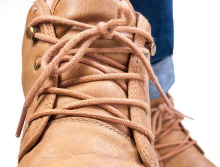 athletic wear: Brown shoe on white background Stock Photo