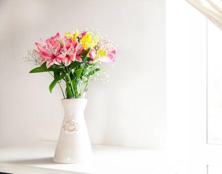 alstroemeria: Alstroemeria flowers in vase on table