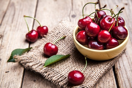 Cherries on wooden table, macro background, fruits, berries Stock Photo
