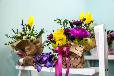 blosom: bouquet of fresh yellow tulips  on green background