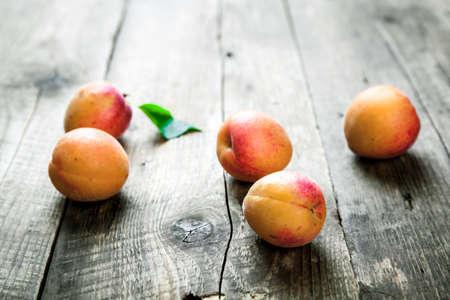 apricot kernels: Fresh apricots on wooden background. fruit Stock Photo