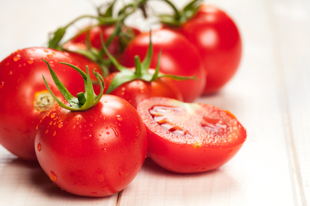 tomato: red tomatoes on wooden table Stock Photo