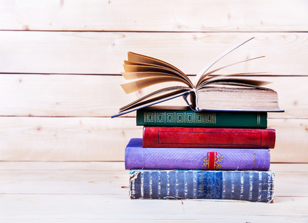 old: Old books on a wooden shelf.