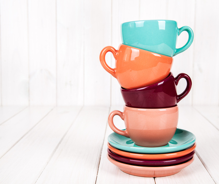 colorful coffee cups on white wooden background stock photo picture