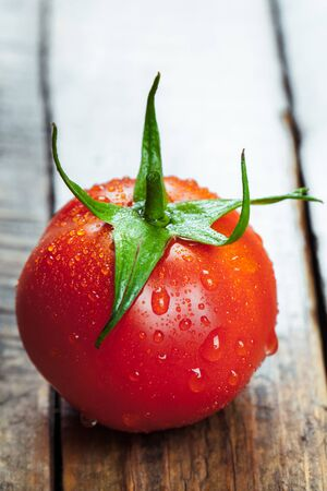 Tomatoe on old wooden table.