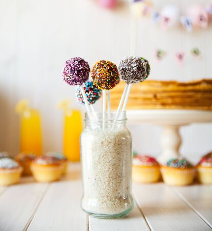 pop: cake pops on the holiday table. sweetness. candies on wooden background