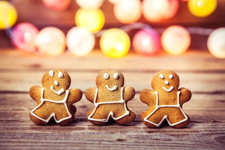 comfort food: Christmas food, Gingerbread Man on a wooden background. garland for the new year