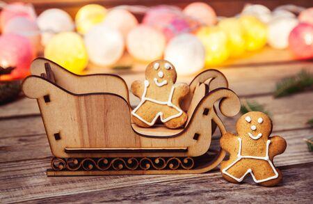 christmas food: Christmas food. Gingerbread man. Garland. Santas sleigh on a wooden background