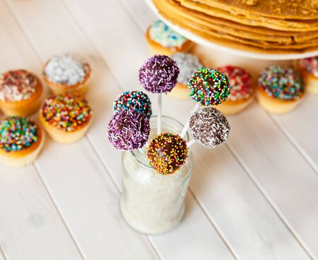 cake pops on the holiday table. sweetness. candies on wooden background