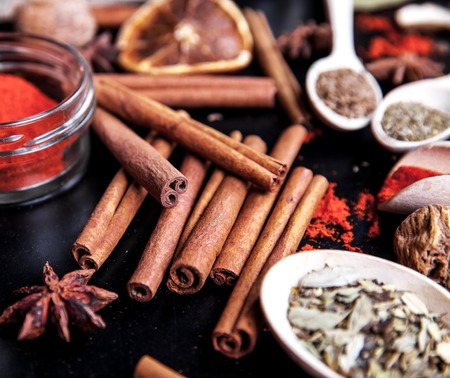 barberries: wooden spoons with spices on black background Stock Photo