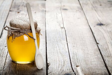 healthy living: Bowl of honey on wooden table. Symbol of healthy living and natural medicine. Aromatic and tasty.