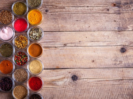 variability: Spices in jars on wooden background. Food Stock Photo