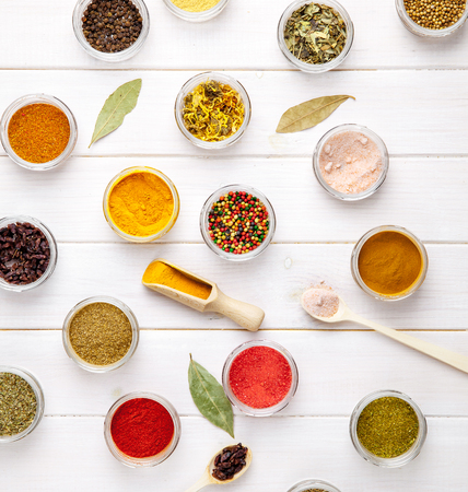 variability: Spices on white wooden background. Food