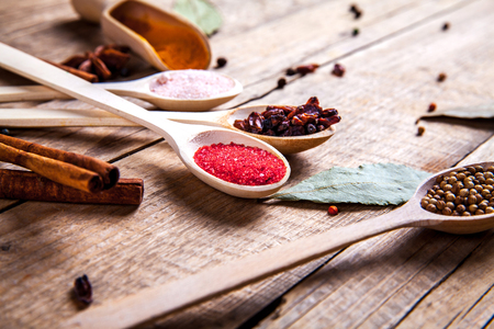 svan: Spices on wooden background. With empty space for advertising text Stock Photo