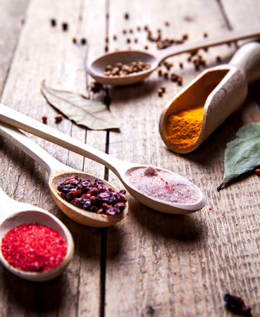 variability: Spices on wooden background. With empty space for advertising text Stock Photo