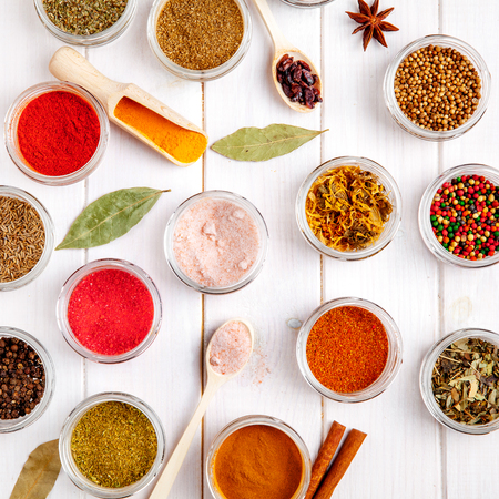 svan: Spices on white wooden background.