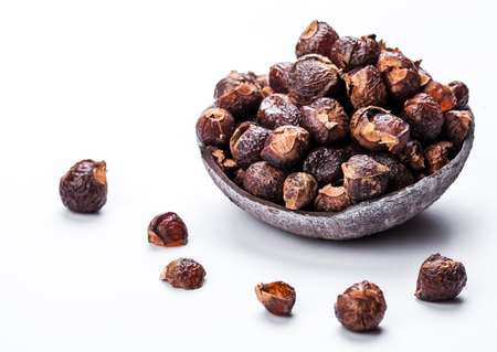 soap nuts on a white background in the coconut.