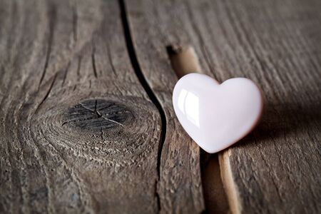 full willow: Wooden hearts on a wooden background Stock Photo