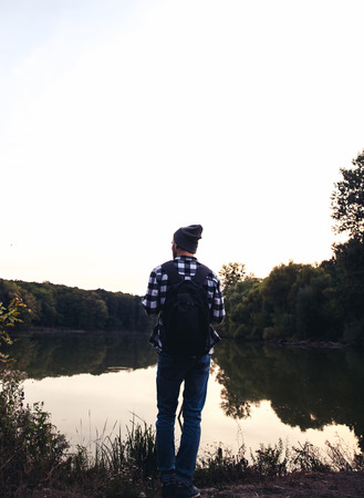 man standing alone: Young Man standing alone outdoor Travel Lifestyle concept with lake