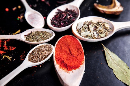 svan: spice in wood spoon on a black background. food Stock Photo