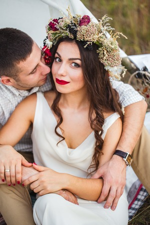 happy newly married couple posing in nature Stock Photo