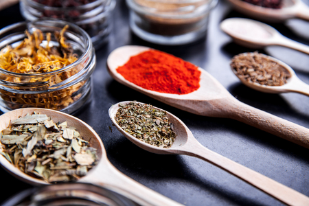 barberries: Spices on black background in special jars. Food Stock Photo