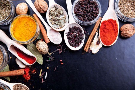 svan: Spices on black background in special jars. Food Stock Photo
