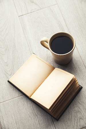 spread sheet: Large cup of coffee and open book.